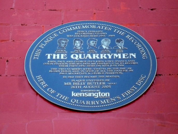 "This plaque commemorates the recording here of The Quarrymen's first disc. Percy Phillips recording studio was located here 1955-1969. The Quarrymen. John, Paul and George plus John Lowe (piano) and Colin Hanton (drums) paid Mr Phillips 17 /6 to record their first disc here on 17th July 1959. The two numbers were ""That'll Be The Day"" by Buddy Holly and ""In Spite Of All The Danger"" by Paul McCartney & George Harrison. In 1960 they became The Beatles."